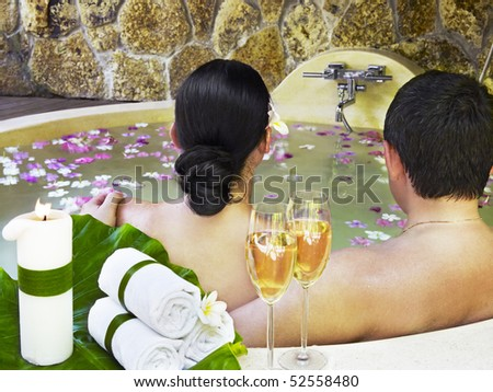 Loving couple relaxed in the bath during their honeymoon