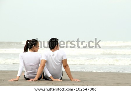 loving couple relaxing and spending quality time with each other on beach