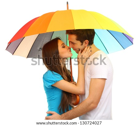 Loving couple standing with umbrella isolated on white