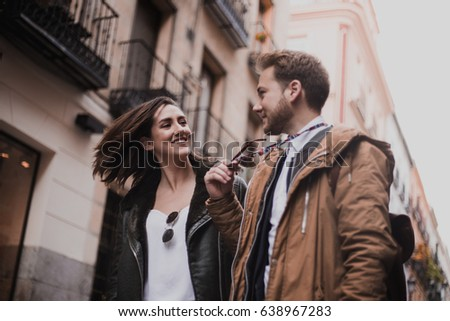 Loving couple walking down the street. Happy friends walking through the city. #638967283
