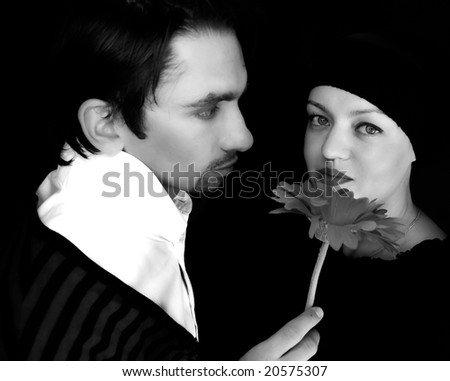 loving couple with a red flower