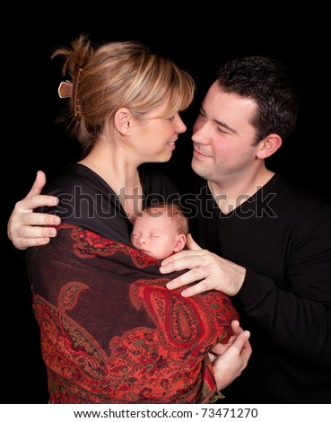Loving couple with their 18 days old baby