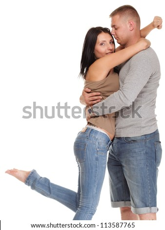 Loving embracing Portrait of a beautiful young happy smiling couple isolated