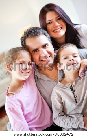 Loving family portrait together at home smiling