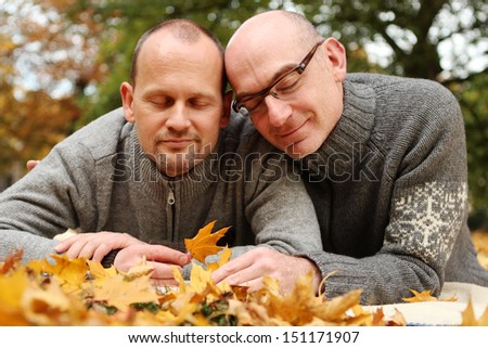 Loving gay couple with closed eyes Autumn Portrait