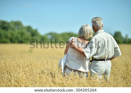 Loving mature couple in field  at summer,back view
