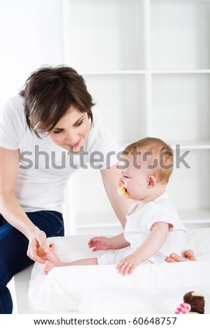 loving mother and baby girl at home