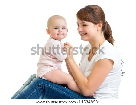 Loving mother having fun with her baby toddler