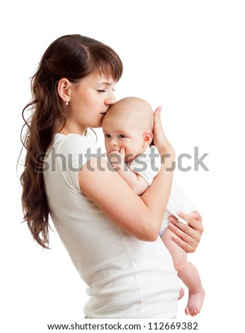 loving mother kissing her baby isolated on white background