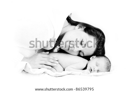 loving mother puts head on her sleeping newborn