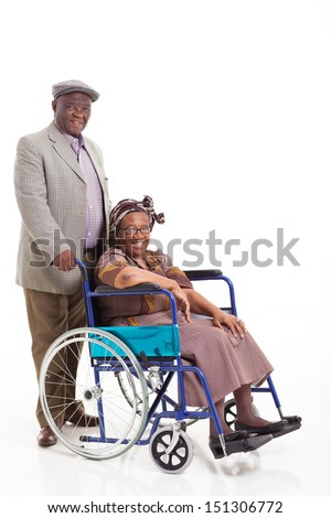 loving senior african man pushing his wife on wheelchair isolated on white