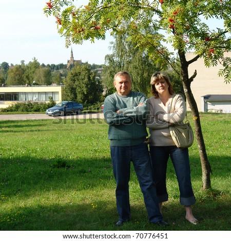 Loving Senior Couple Walking and Enjoying the Outdoors Together.