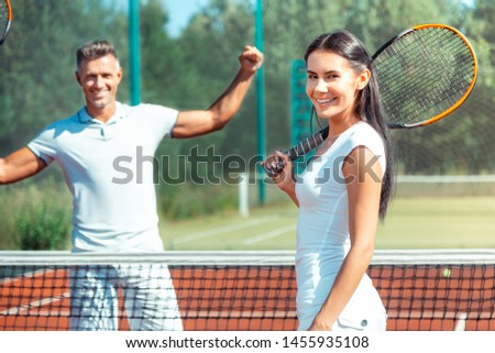 Loving wife smiling. Loving wife smiling after playing tennis at the weekend with handsome husband #1455935108