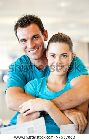 loving young couple at airport waiting for their flight