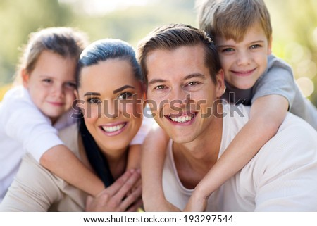 loving young family having fun together outdoors #193297544