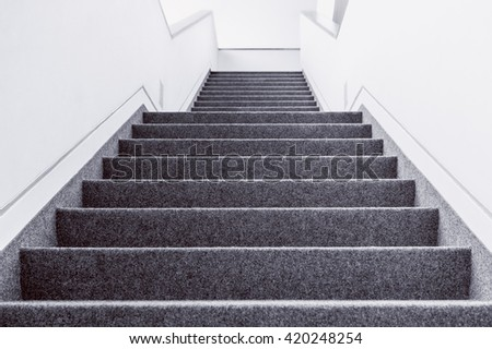 Low angle black and white picture of empty indoor steps #420248254