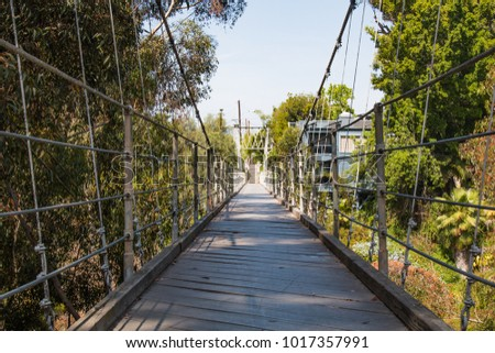 Low angle of the 375 feet long Spruce Street Suspension Bridge in San Diego, California.