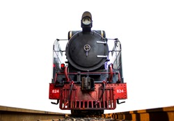Low angle shot Front of Old steam locomotive Pacific on the tracks from Thailand isolated on white background.