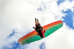 Low Angle Shot Of A Tandem Paragliders Team On The Take Off