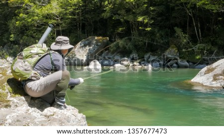 low angle shot of an fly angler hooking a trout