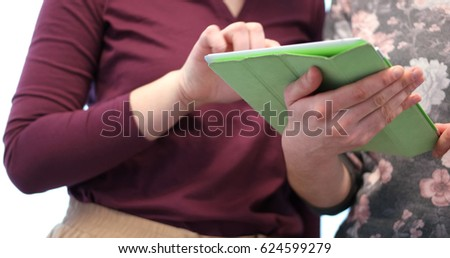 low angle shot of Businessman And Woman Using Digital Tablet #624599279