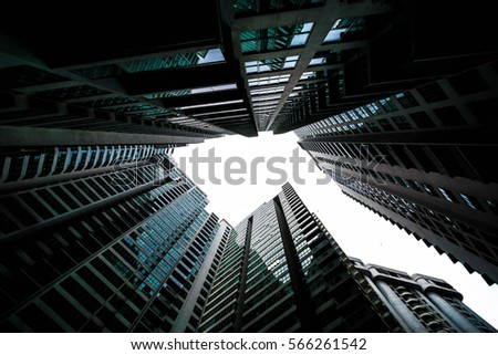 Low angle shot of modern glass city buildings with clear sky background.  #566261542