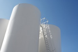 Low angle shot of Oil Refinery Tanks