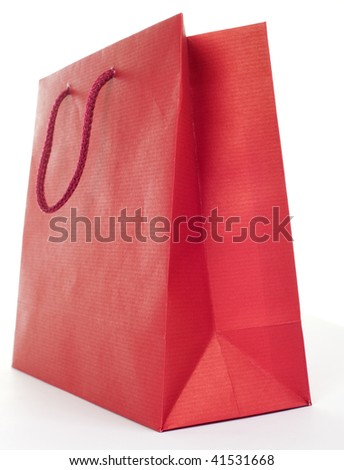 Low angle shot of red present bag on white background