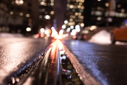 Low angle shot of Toronto streets after a wet rainy day at night
