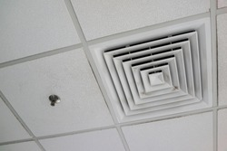 Low angle view air conditioning vent on ceiling