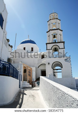 Low-angle view at the path leading to Greek church on Santorini island