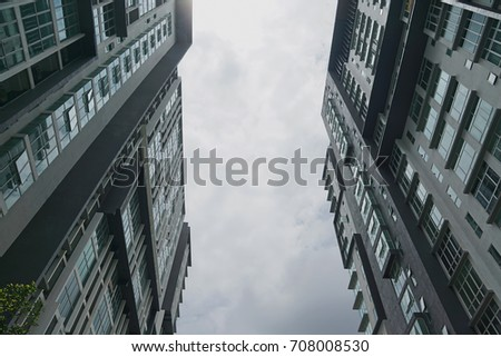 Low angle view building against cloudy sky                                 #708008530