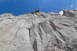 Low angle view of a cliff face during the day