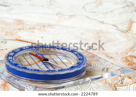 Low angle view of a compass on a topographic map