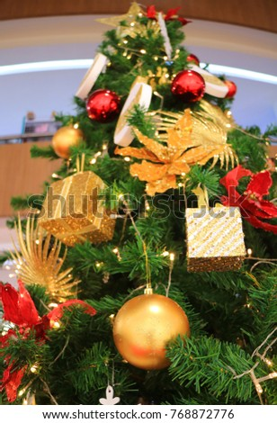 low angle view of a decorated big christmas tree full of gorgeous ornaments