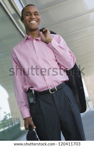 Low angle view of a happy African American businessman standing in office