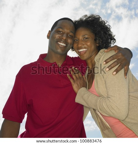 Low angle view of African couple smiling