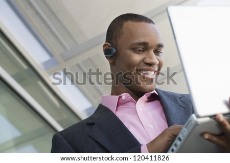 Low angle view of an African American business man working on laptop