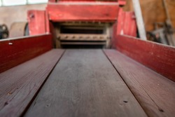Low angle view of an antique agricultural machine. The wooden part of an old vintage farming machinery. Museum in Kootenays, British Columbia, Canada