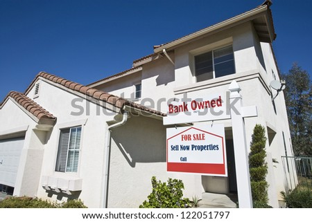 Low angle view of bank owned house for sale