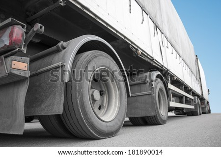 Low angle view of big truck on asphalt #181890014