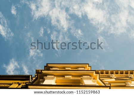 Low angle view of building against cloudy sky. Photo taken in Berlin, Germany.  #1152159863