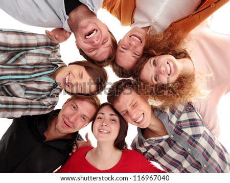 Low angle view of business people with their heads together - stock photo