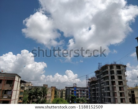 Low angle view of city building against cloudy sky #1188152509