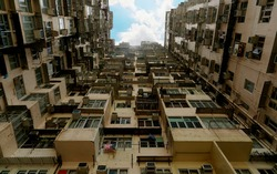 Low angle view of crowded residential towers in an old community in Quarry Bay, Hong Kong ~ Scenery of overcrowded & narrow apartments, a phenomenon of high housing density & housing shortage in HK