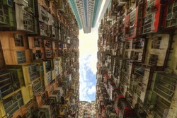 Low angle view of crowded residential towers in an old community in Quarry Bay, Hong Kong ~ Scenery of overcrowded narrow apartments, a phenomenon of high housing density  housing blues in HK