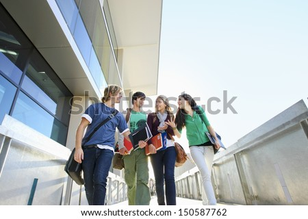 Low angle view of four university students on campus