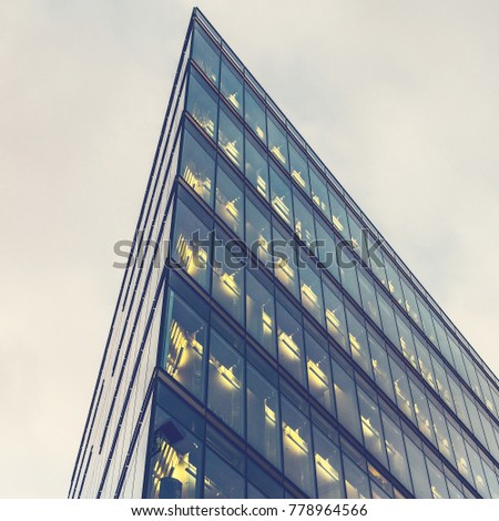 low angle view of futuristic triangle office building