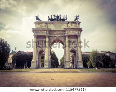 Low angle view of historical building Peace Arch against cloudy sky in Milan, Italy #1154792617