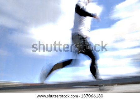 low angle view of jogger in blurred motion